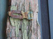 Weathered lock. Old weathered lock against chipped painted Stock Image
