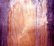 Weathered magenta toned fiberboard texture. Royalty Free Stock Photography