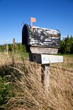 Weathered mailbox. Mailbox in the countryside with blue sky Royalty Free Stock Photos