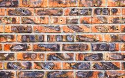 Weathered manchou a parede de tijolo vermelho velha Foto de Stock Royalty Free