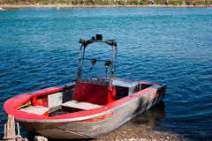 Weathered Metal Boat in Water Royalty Free Stock Images