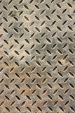 Weathered metal floor cover Royalty Free Stock Images
