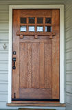 Weathered Misson Wood door. Weathered Misson style Wood door with beveled glass windows on California Bungalow stock images