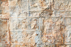 A weathered natural sandstone brick wall Royalty Free Stock Photography