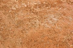 Weathered ochre-colored wall, close-up with copy space royalty free stock image