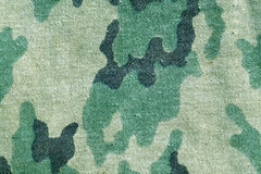 Weathered old camouflage uniform pattern. Stock Photo