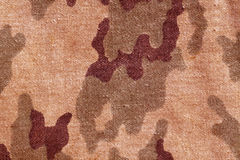 Weathered old camouflage uniform pattern. Stock Photos