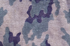 Weathered old camouflage uniform pattern. Royalty Free Stock Image
