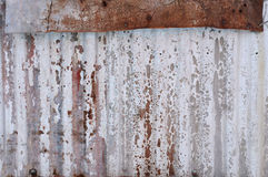 Weathered and old corrugated iron metal background Stock Images