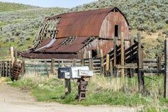 Weathered old farm barn in Idaho stock photography