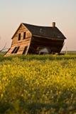Weathered old farm house. In scenic Saskatchewan Canada Royalty Free Stock Photo