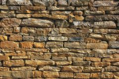 Weathered old stone wall royalty free stock photography