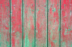 Weathered old wood natural faded green and red painted background Stock Photo