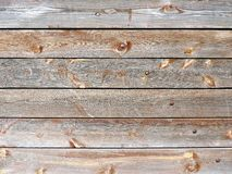Weathered old wood texture with red flaked paint. Royalty Free Stock Photo