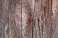 Weathered old wooden plank background. Weathered old wooden plank door background, detailed and textured in different shades of brown and grey Royalty Free Stock Images
