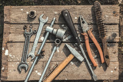 On weathered old wooden surface lie the tools Royalty Free Stock Photo