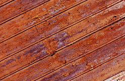 Weathered orange painted wooden wall texture. Stock Images