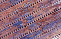 Weathered orange painted wooden wall texture. Royalty Free Stock Photo