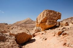 Weathered orange rocks in desert. Weathered orange rocks in stone desert, Israel royalty free stock photo