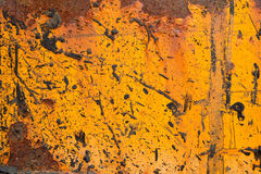 Weathered orange steel plate. Fragment of an old industrial machinery stained with rust and tar Royalty Free Stock Photography