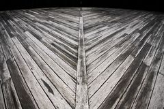 Weathered outdoor diagonal timber deck Royalty Free Stock Image