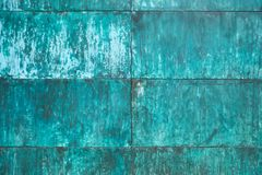 Weathered, oxidized copper wall structure stock images