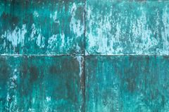 Weathered, oxidized copper wall structure royalty free stock image