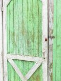 Weathered paint on shed door. Light green paint color on weathered farm shed door Royalty Free Stock Photos