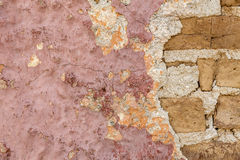 Weathered painted wall with bricks Stock Photos