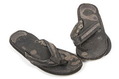 Weathered Pair of Worn-Out Black Leather Sandals Royalty Free Stock Photos