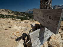 Weathered PCT sign. An old wooden weathered sign pointing the way for the Pacific Crest Trail at Cutthroat Pass in Washington royalty free stock image