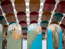 Weathered and peeling skateboards mounted on a rail on a sunny d stock images