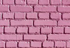 Weathered pink color brick wall pattern. Stock Photo