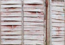 Weathered pintou o fundo marrom da cerca Foto de Stock