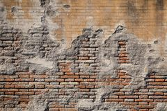 Weathered plaster and brick wall textured background Stock Photos
