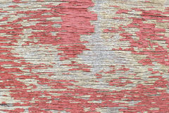Weathered plywood with red paint peeled off Royalty Free Stock Photo