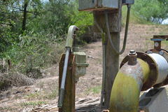 Weathered pump and metal pipe Royalty Free Stock Images