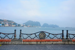 Weathered railing and Halong Bay Stock Photography