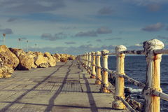Weathered railings and seafront promenade Royalty Free Stock Photography