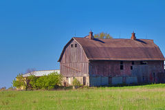 Weathered Red Barn with a Cupola on Each End Stock Photography