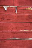 Weathered red barn siding. With peeling paint Stock Photo