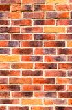 Weathered red brick wall as background texture stock photography