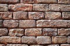 Weathered red brick wall Royalty Free Stock Photos