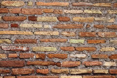 Weathered red brick wall Stock Photos