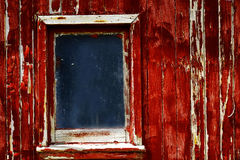 Weathered Red Paint Window on Old Wood stock photo