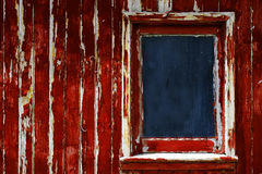 Weathered Red Paint Window on Old Wood. Peeling red paing on weathered old wooden window frame Stock Images
