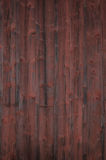 Weathered red painted wooden panel Stock Images