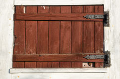 Weathered red plank window shutter Royalty Free Stock Images