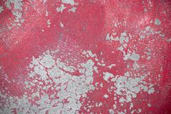 Weathered red plaster on asphalt road. Concrete wall grungy texture photo for background. Red paint and distressed stain. S. Rough concrete texture. Cracked royalty free stock photos