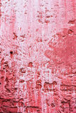 Weathered red plaster wall with paint dripping. Weathered texture of red plaster wall with white paint dripping Stock Images